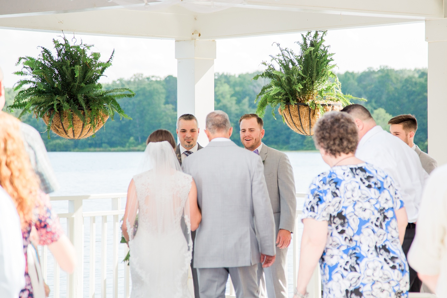 groom reacts to his bride walking down the aisle