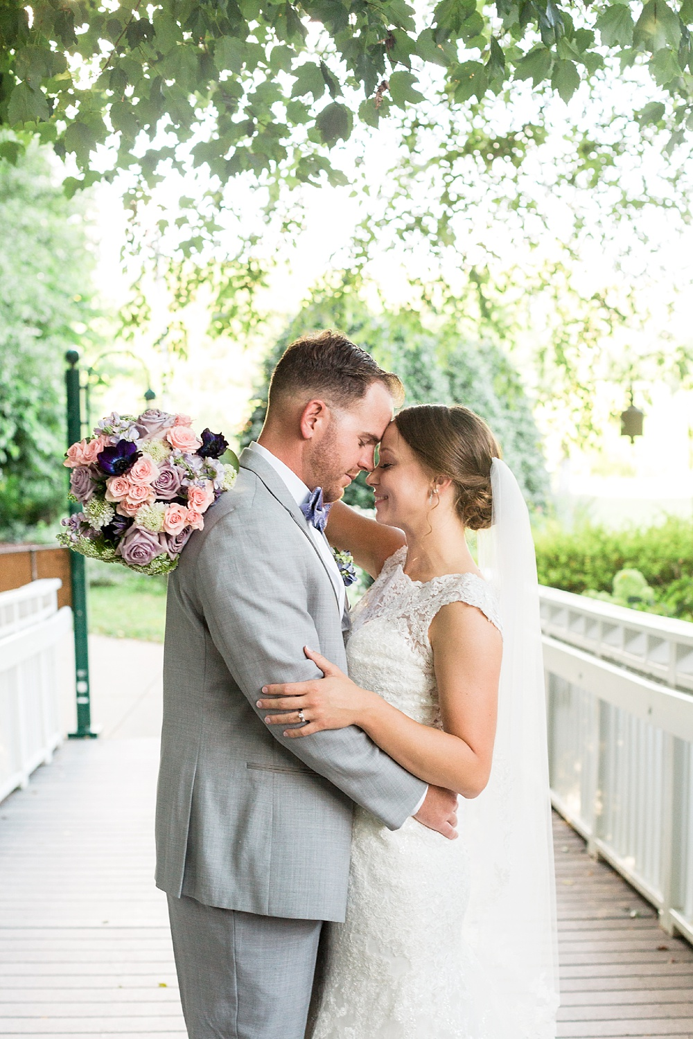 bride and groom touch foreheads
