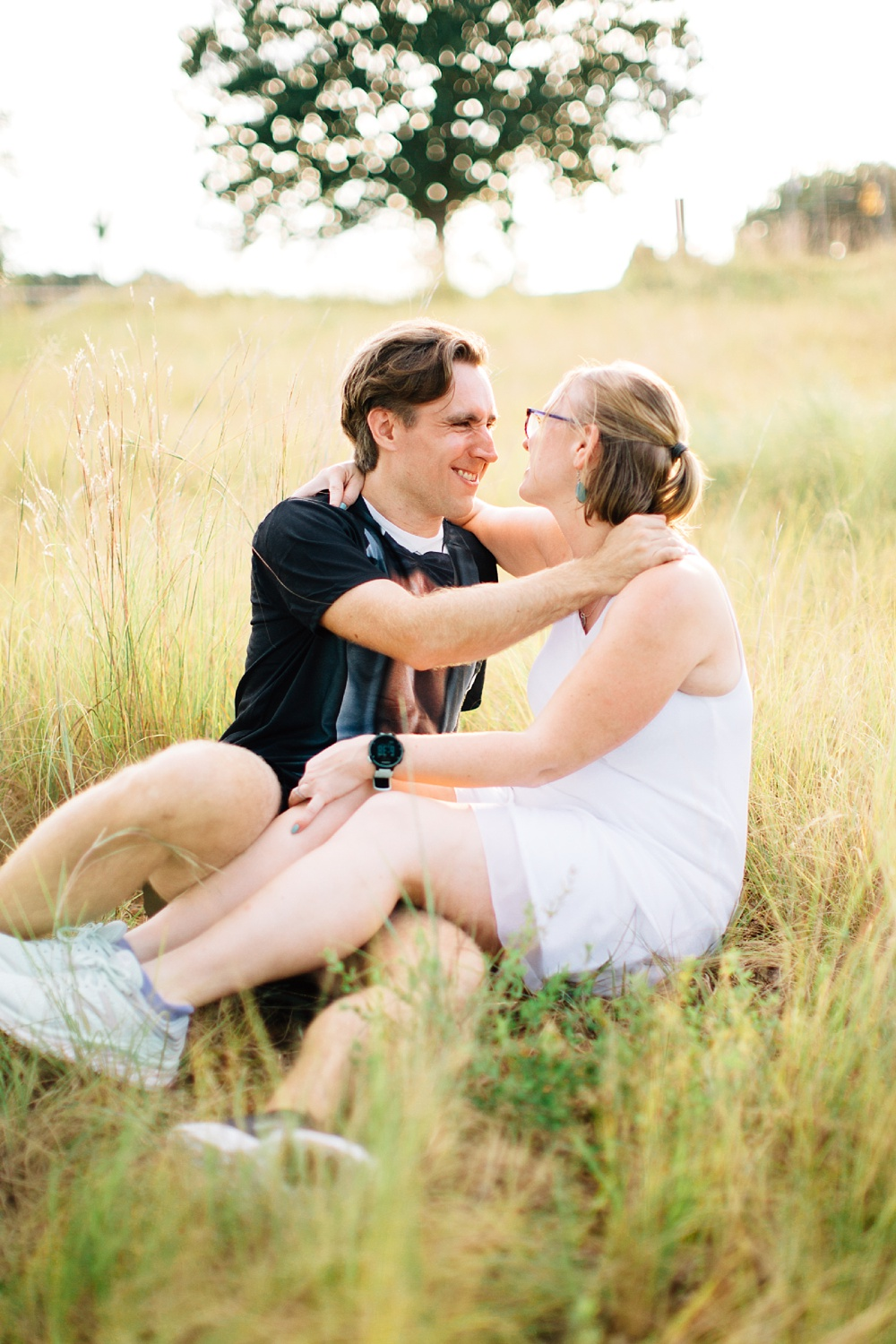 summer engagement session at the north carolina museum of art park