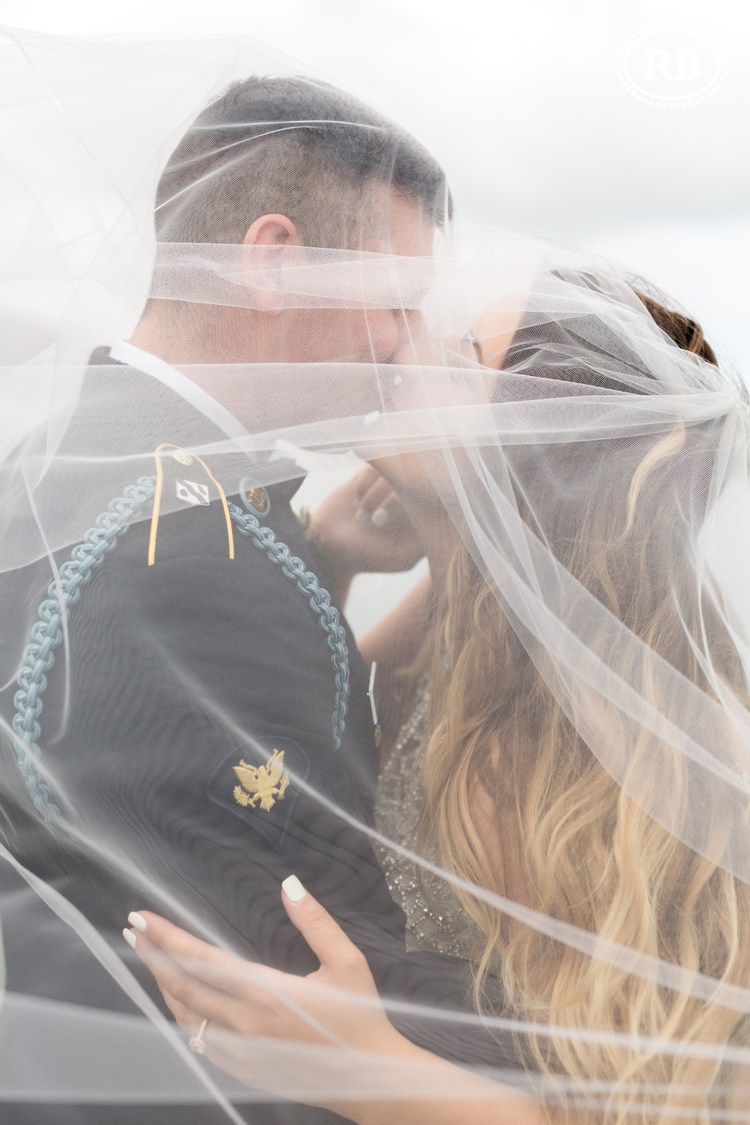 Bride and groom (Olivia and Ryan) share a kiss at their Murrells Inlet SC wedding.