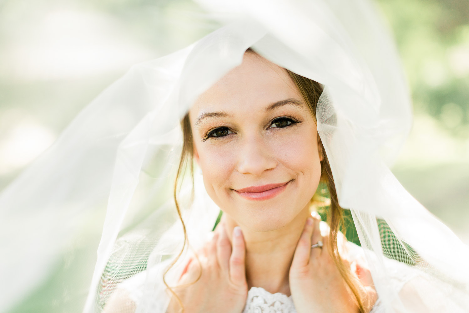 Bride (Katie) smiles during her bridal session at  The Oaks at Salem . Hair by  Kaitlin Savage at Liane Carroll Salon  and makeup by  Merle Norman of Fuquay Varina