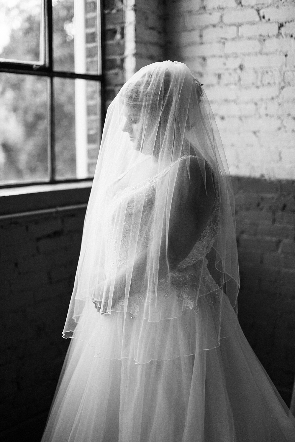 artistic moody bridal portrait at forest hall at chatham mills by rachael bowman photography