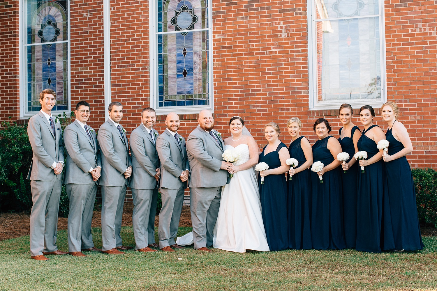 wedding party on the church lawn