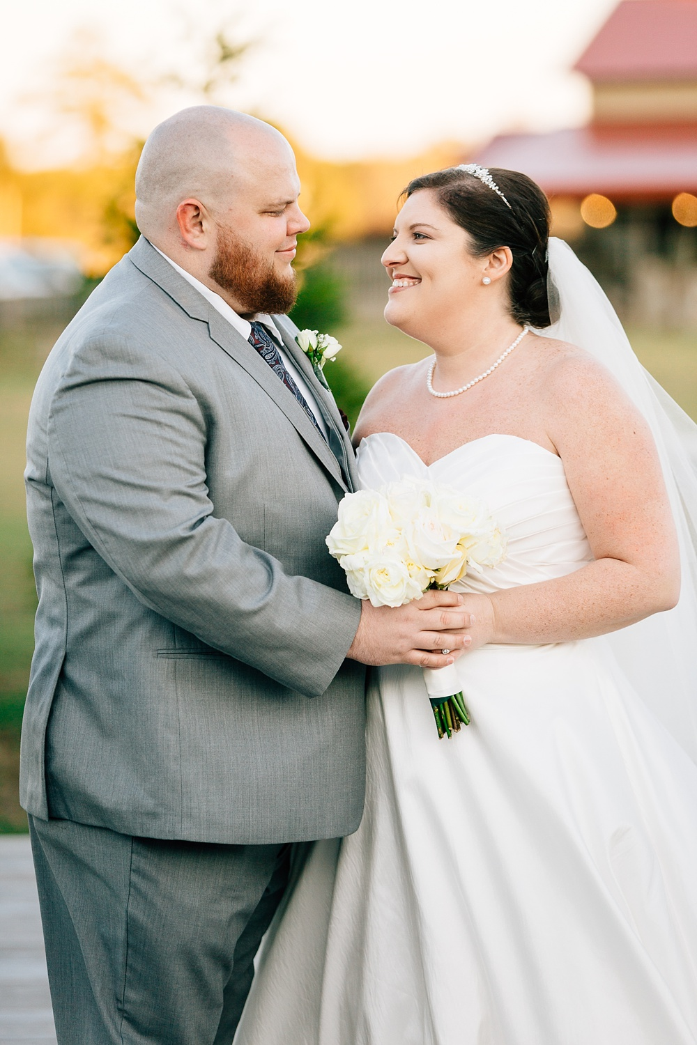 bride and groom at the cotton barn by rachael bowman photography