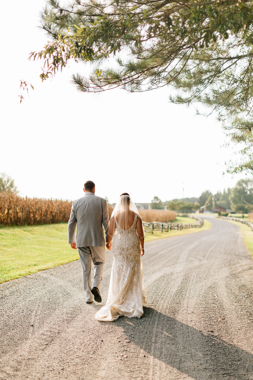 Bride and Groom walking away at Shady Wagon Farms in New Hill NC