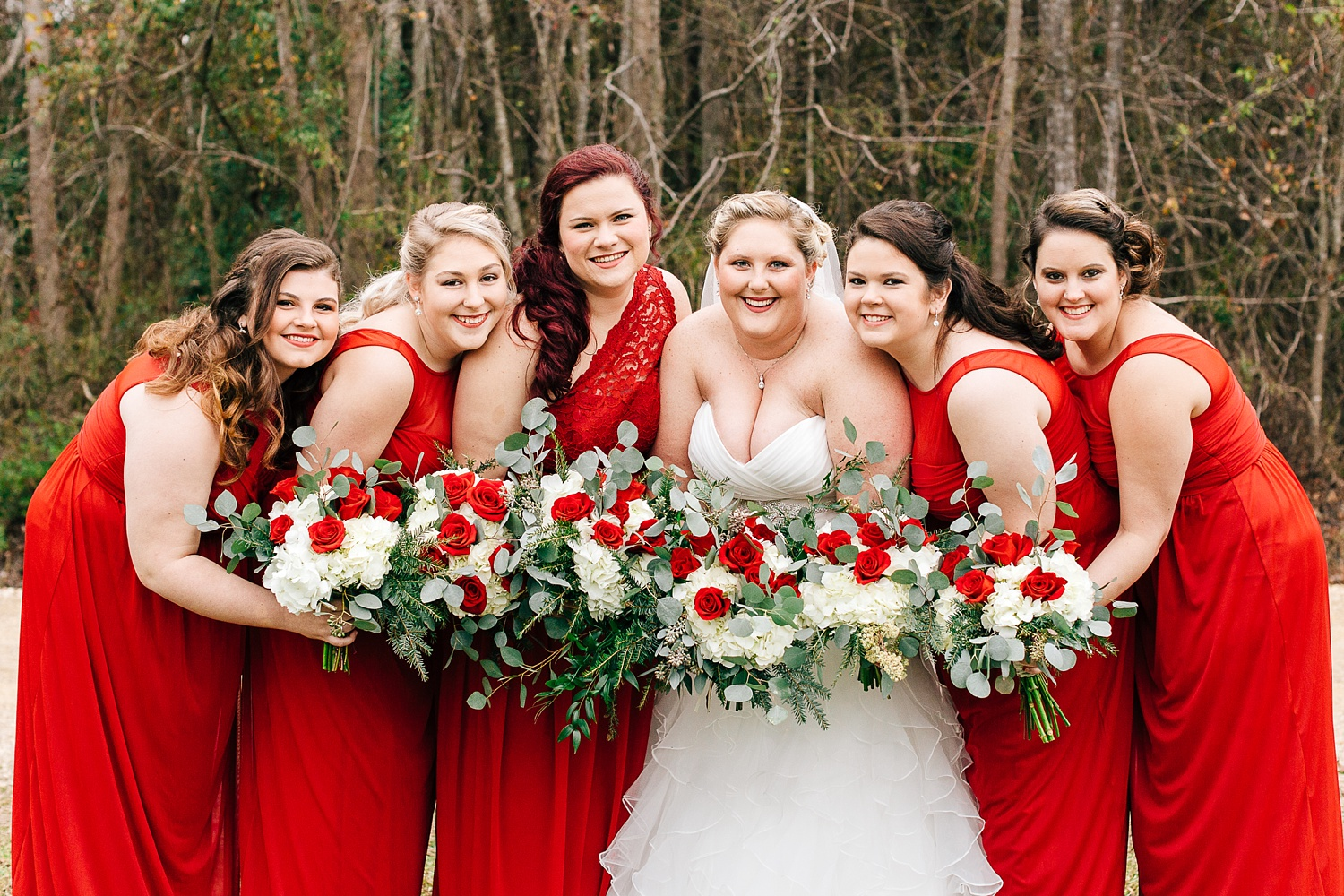 bridesmaids in red winter dresses