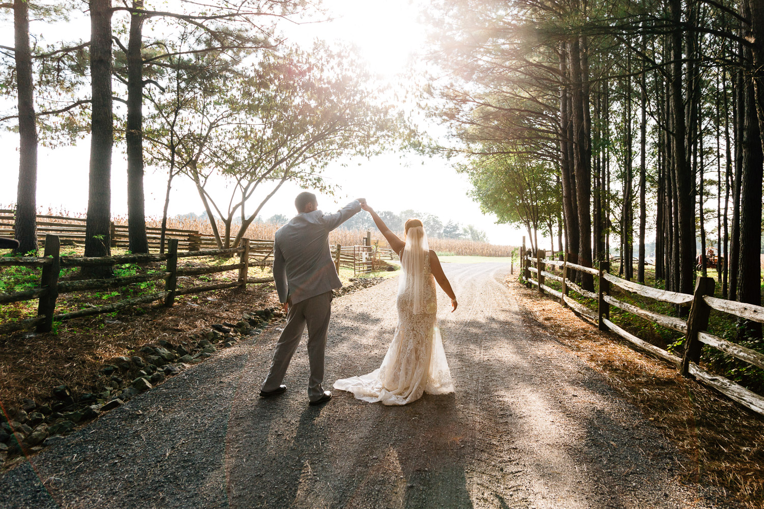 bride and groom dance in the sunset