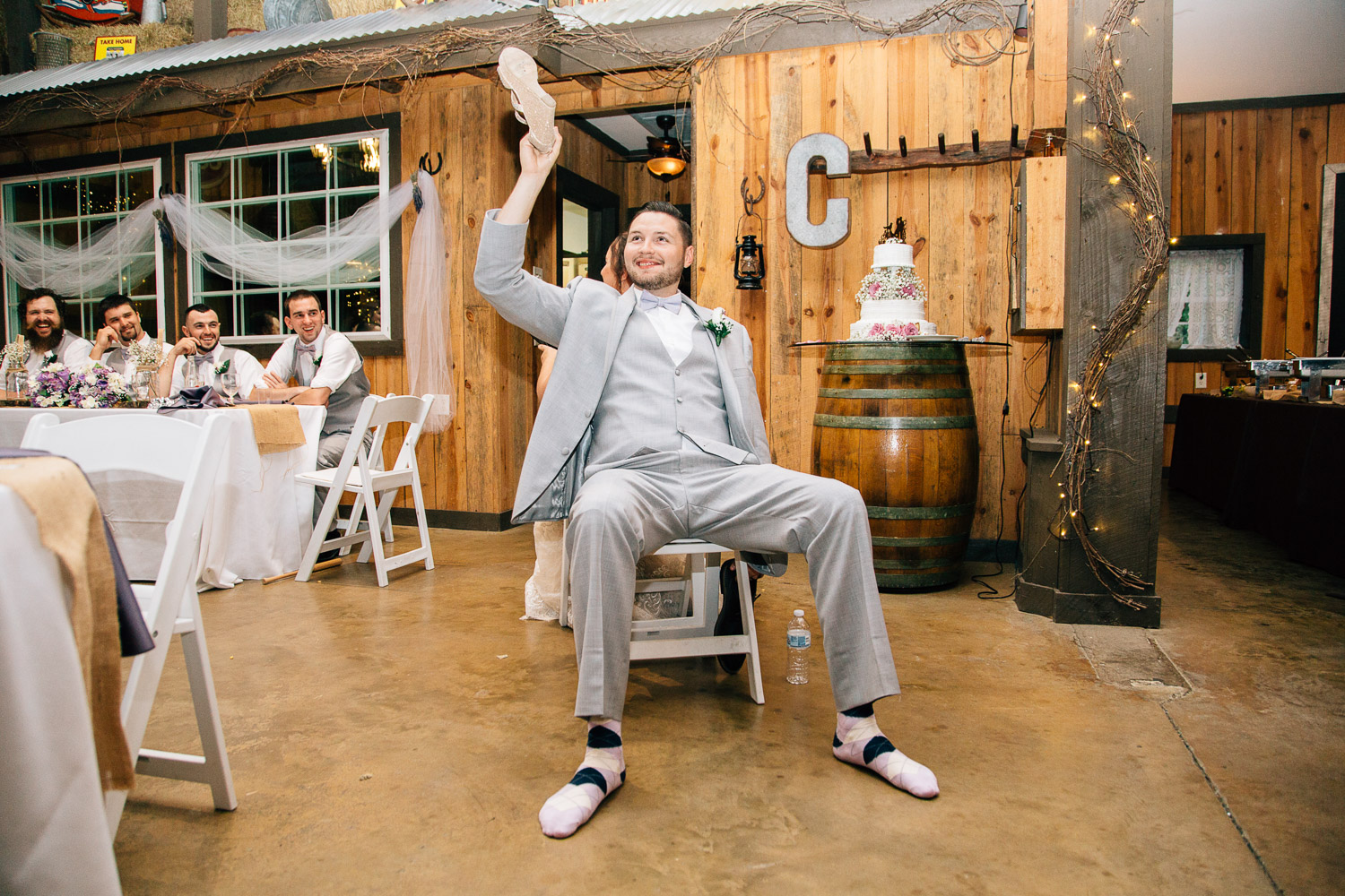 bride and groom play the shoe game at their reception