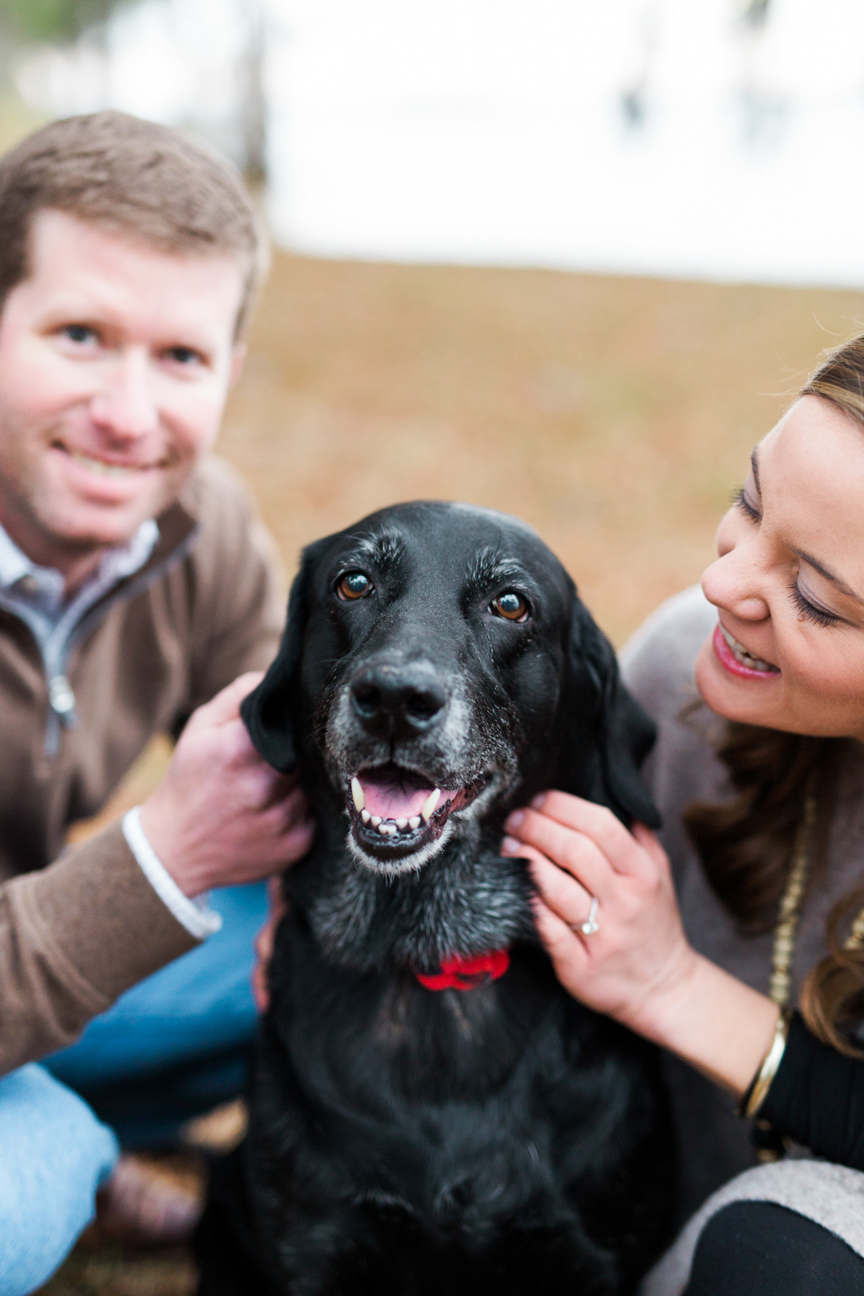 Couple pets dog at Washington NC engagement session