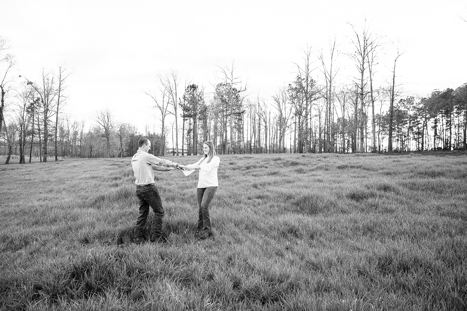couple dances in a wide open grassy pasture