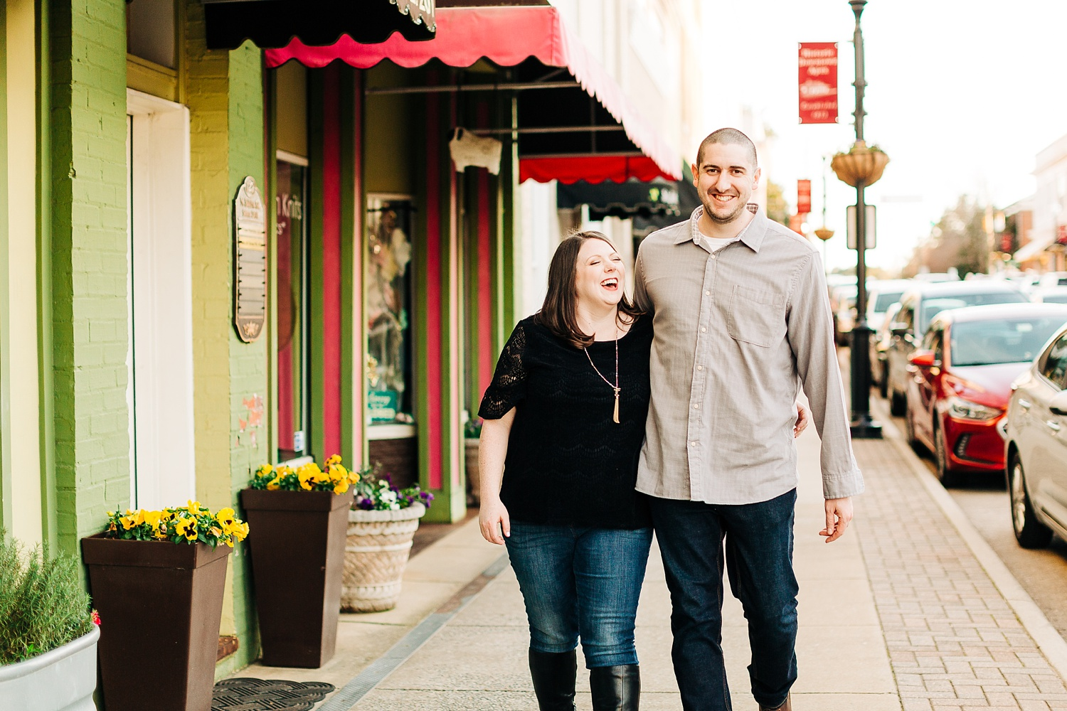 couple walking down a small downtown sidewalk