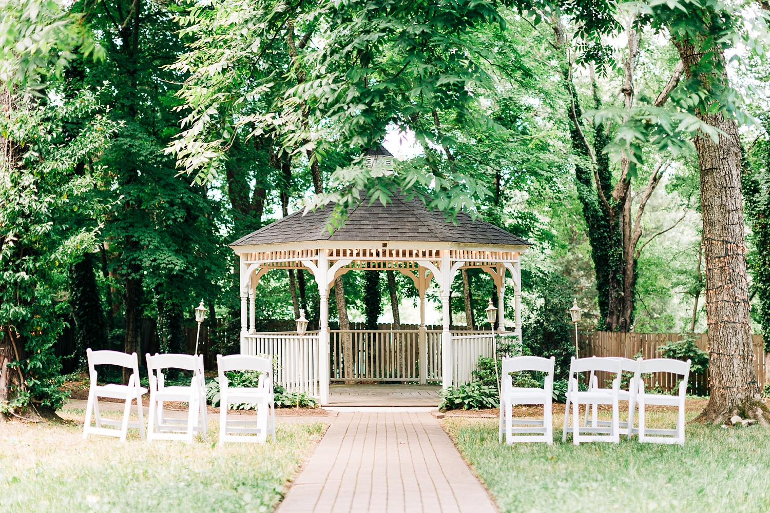 white gazebo wedding ceremony at cooper's landing inn