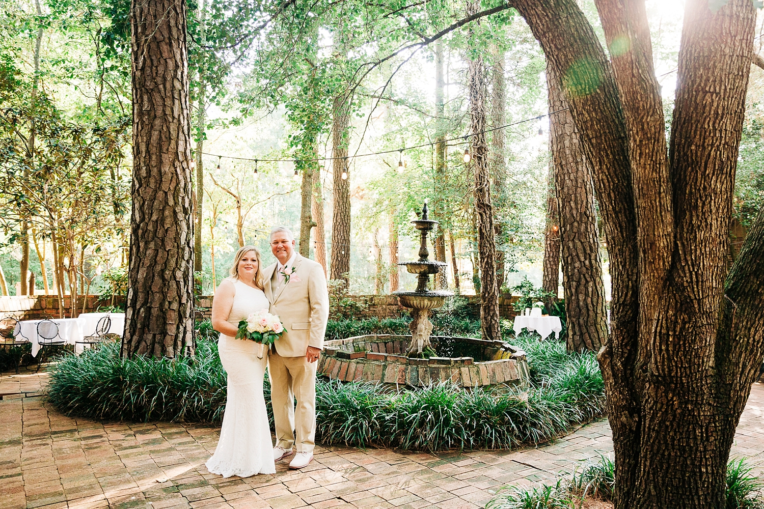 bride and groom in the courtyard at the country squire