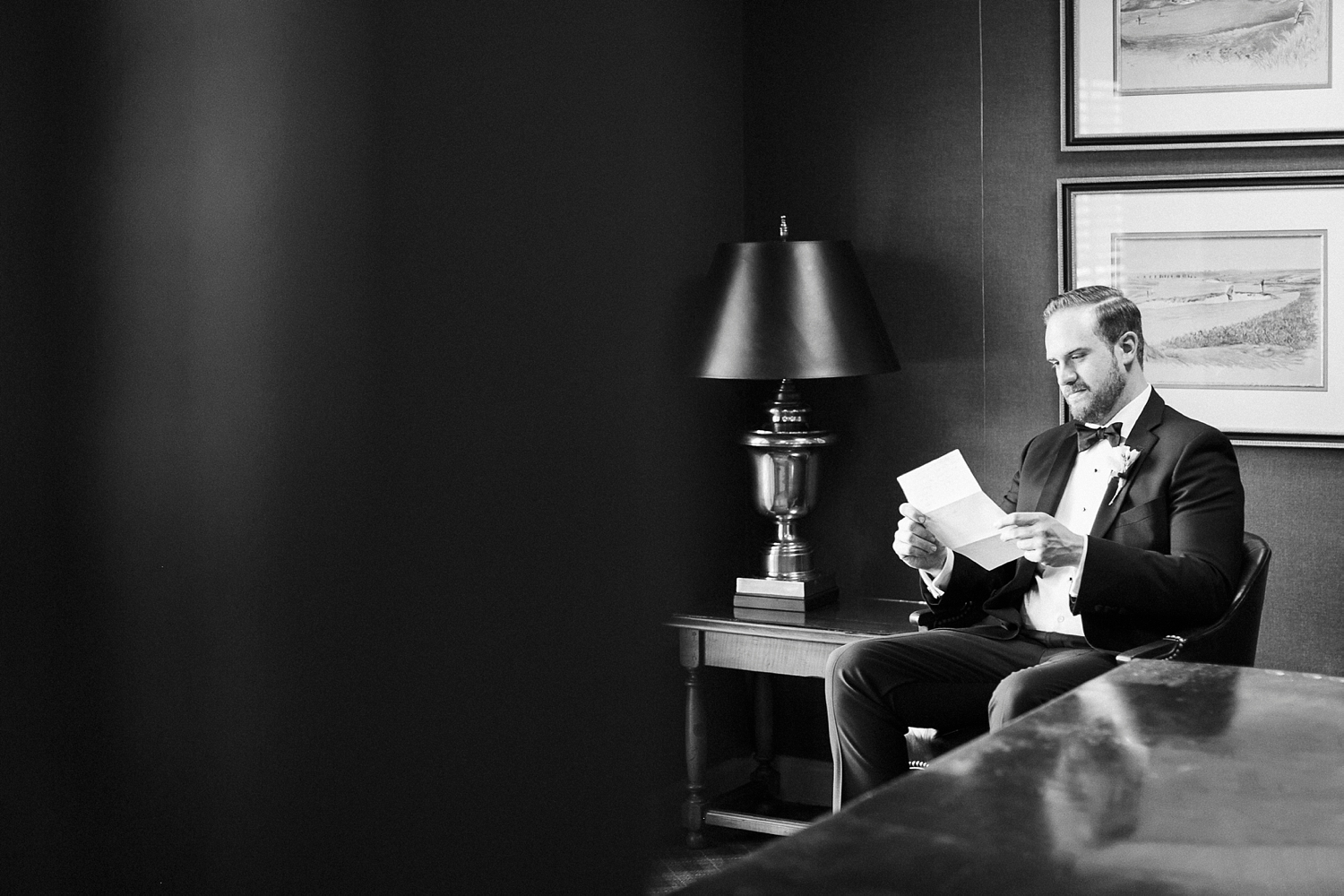 groom reads letter from his bride on his wedding day