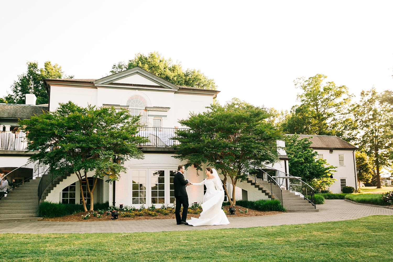 bride and groom dance on the lawn of danville golf club