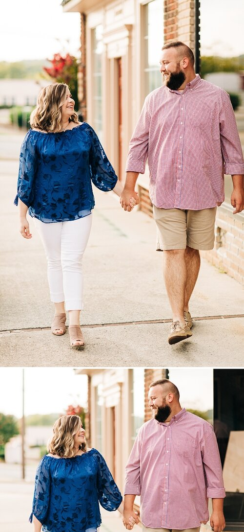 couple walks holding hands in a downtown setting