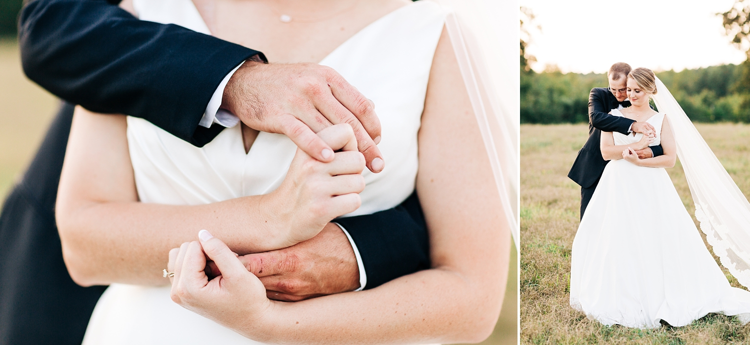 bride and groom embrace in a pasture