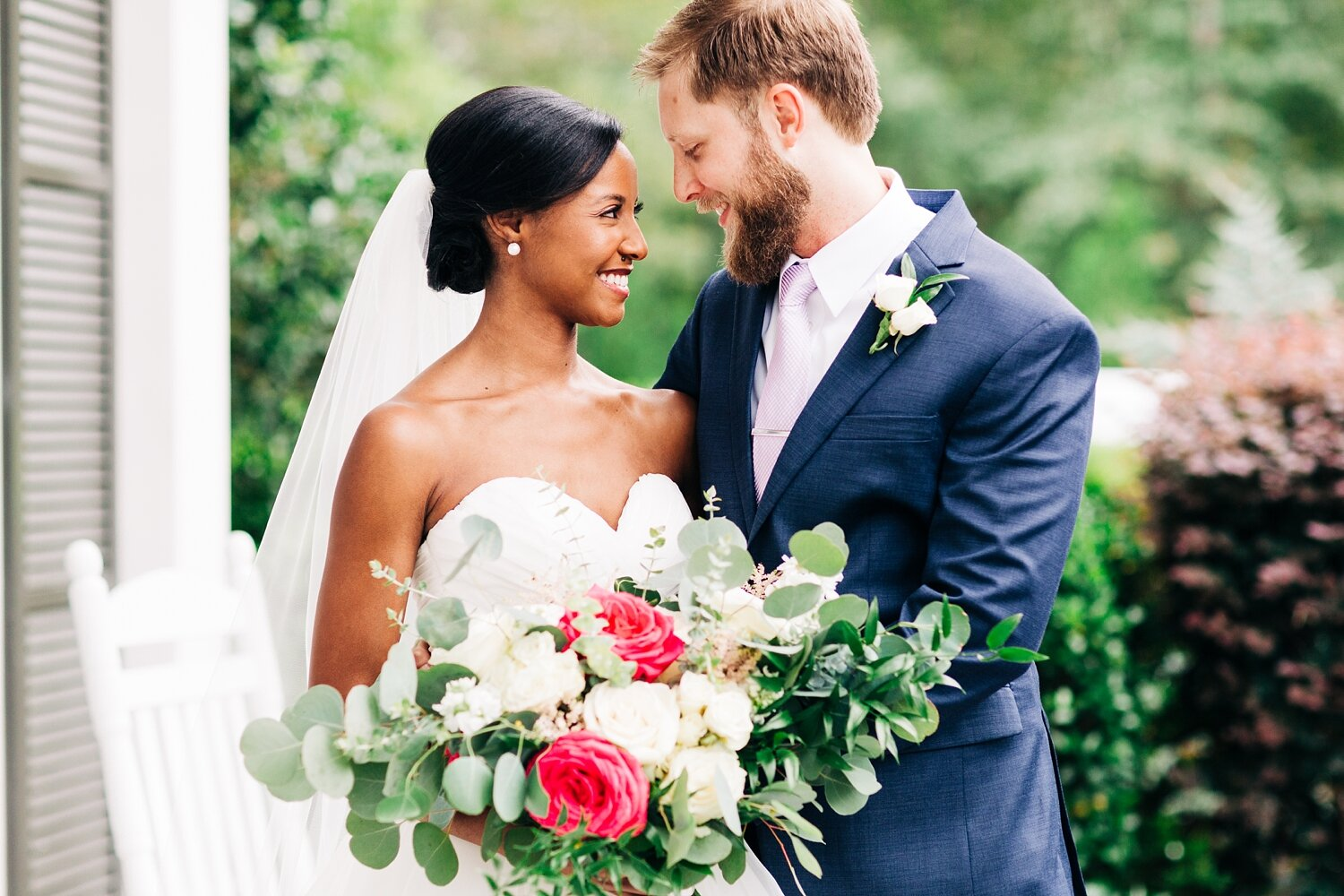 bride and groom on the front porch of highgrove estate wedding venue