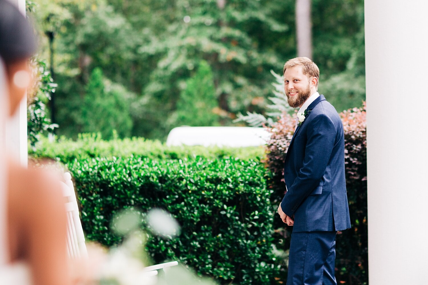 groom sees his bride for the first look on wedding day