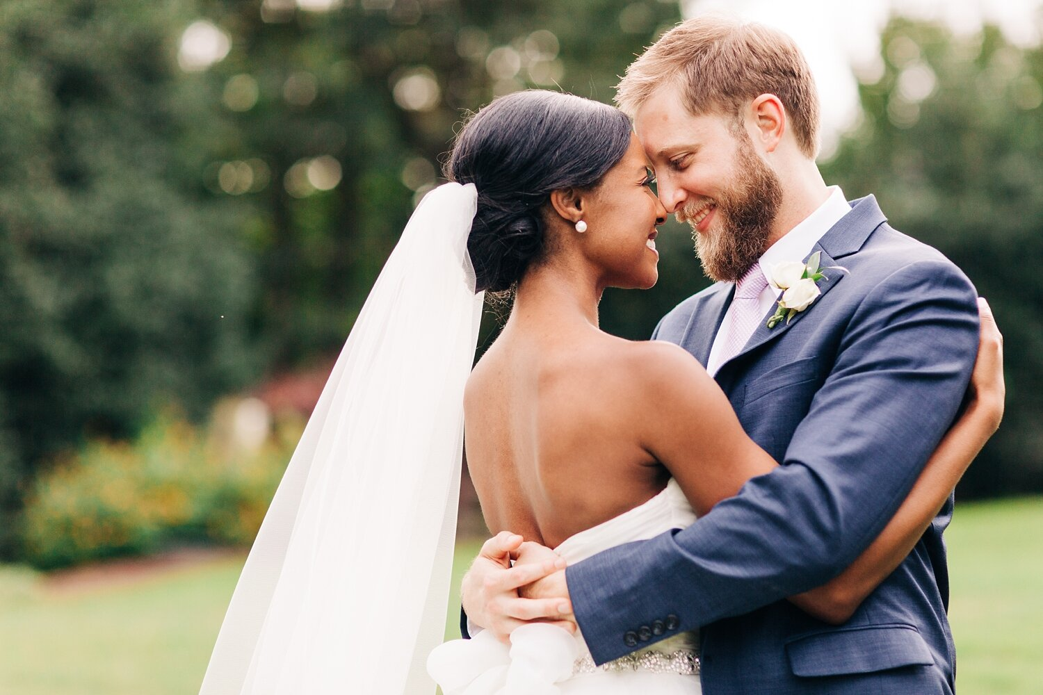 bride and groom hug and touch foreheads