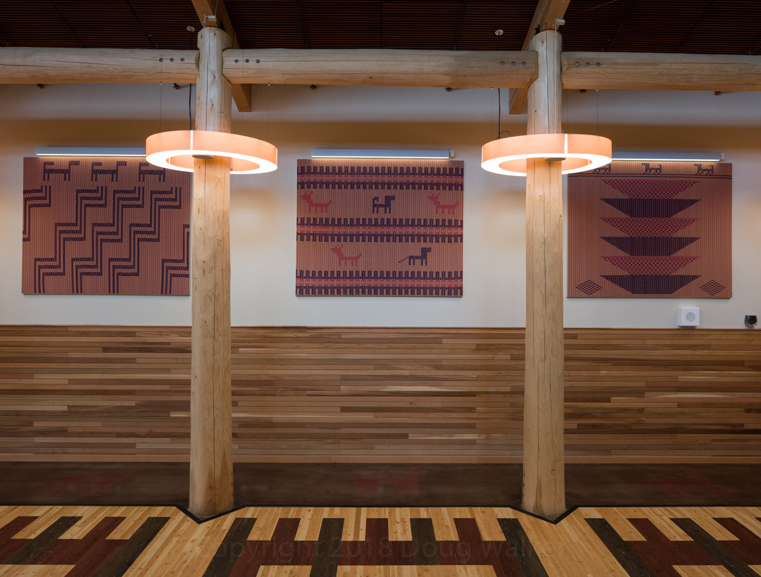 Gathering space features artwork using traditional Skokomish basket patterns,