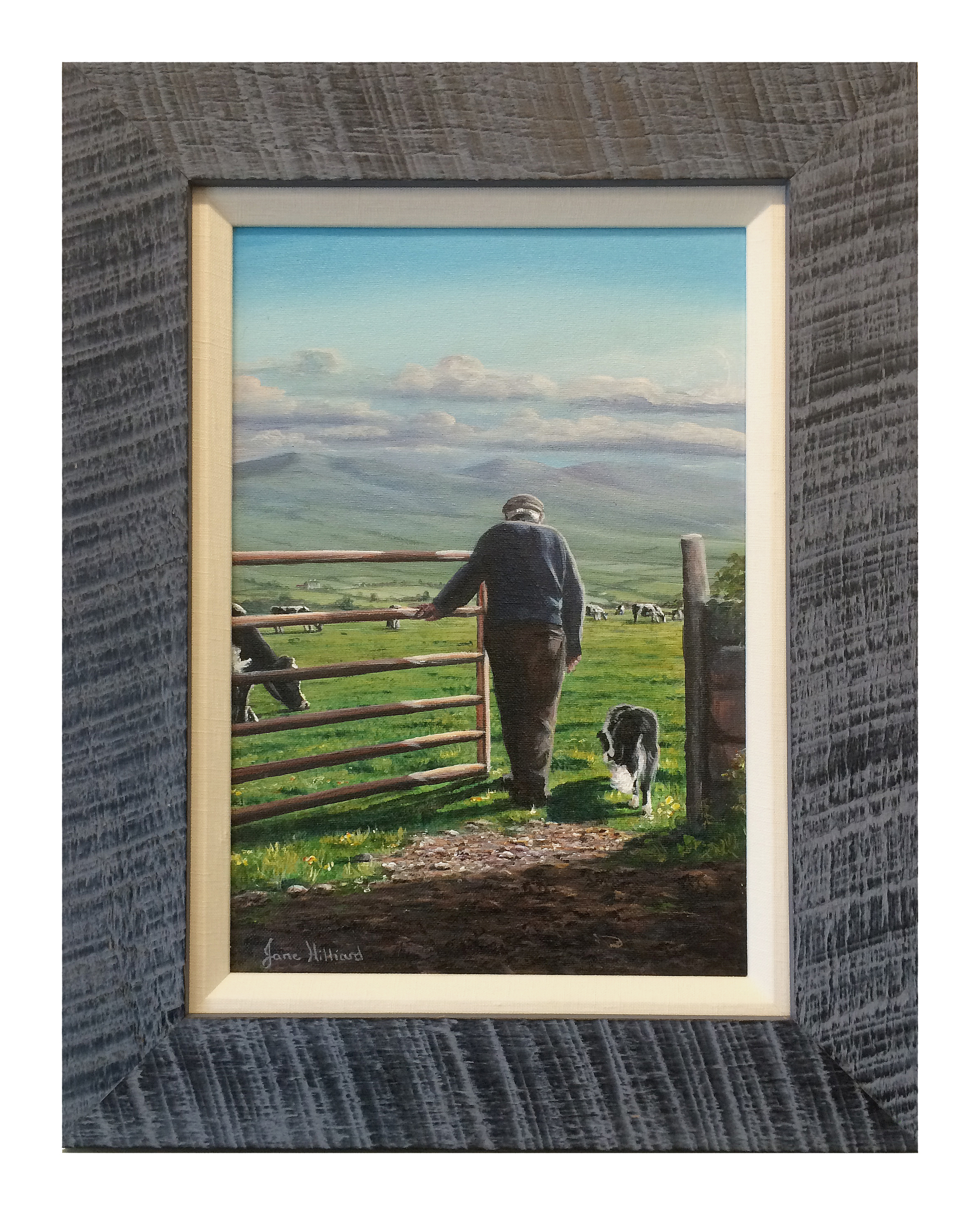 A rough-hewn blue-gray moulding is stacked with a cream-colored fabric liner to frame this small oil painting of an Irish farmer surveying his fields.