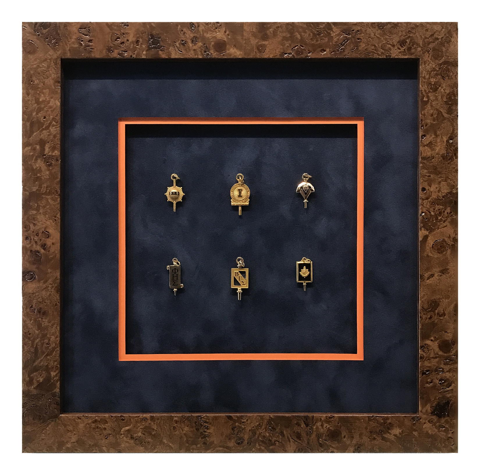 A collection of vintage college club and fraternity pins is nestled within a velvet top mat and thin inner mat in the school colors.