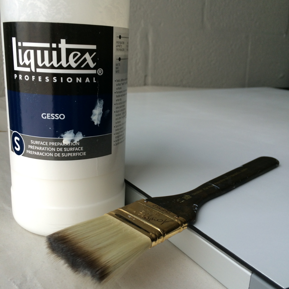 a container of gesso and a paintbrush, die bond painting panel.