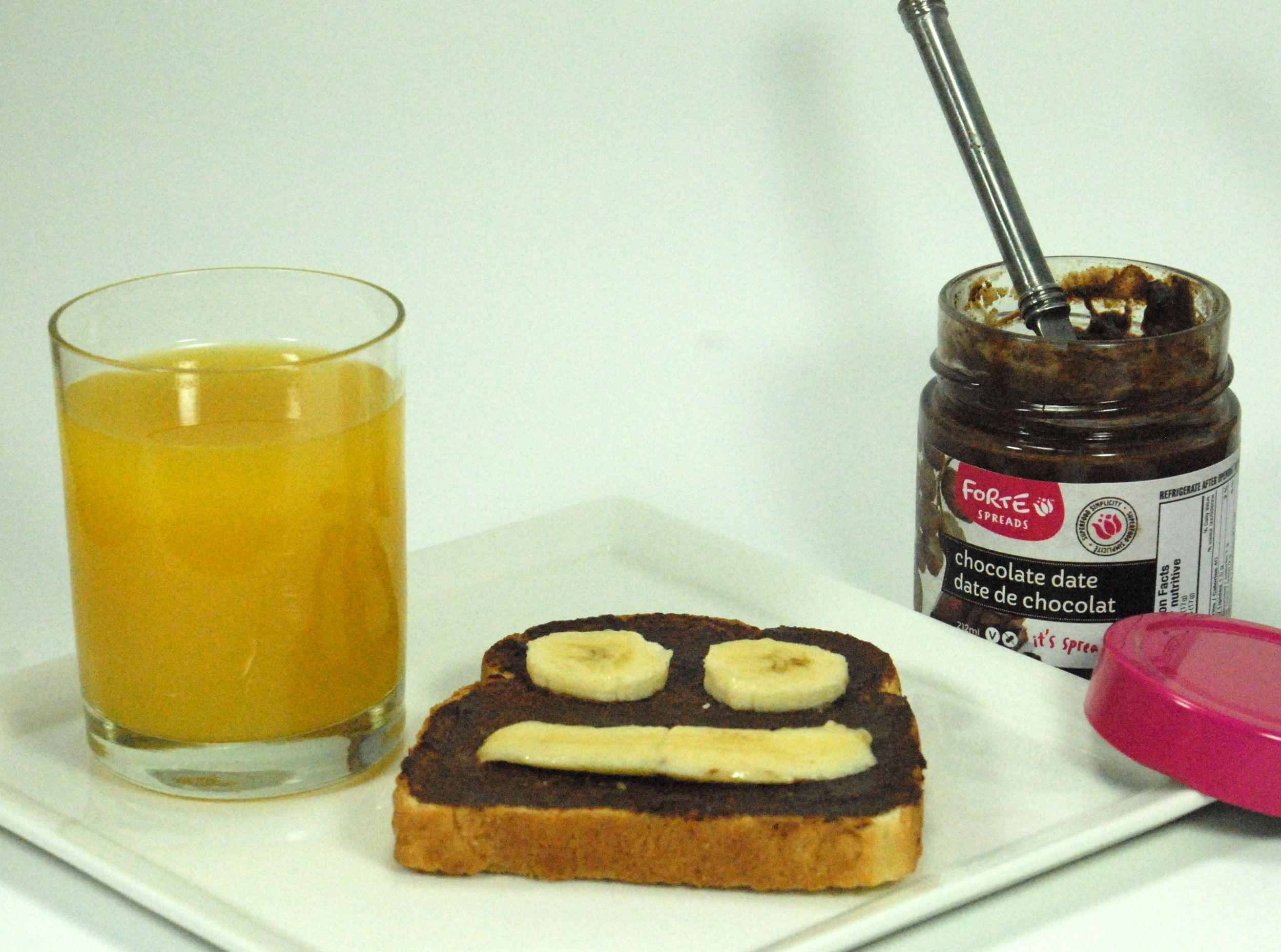 Smiley banana toast with Forte chocolate fruit spread