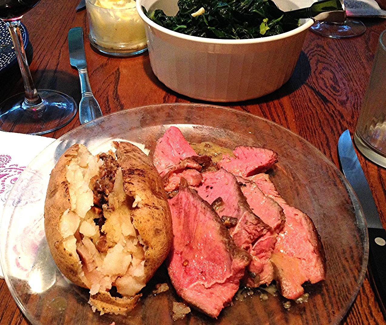 Grass Fed Sirloin Tip Roast Beef with Baked Potato, and Sautéed Swiss Chard.