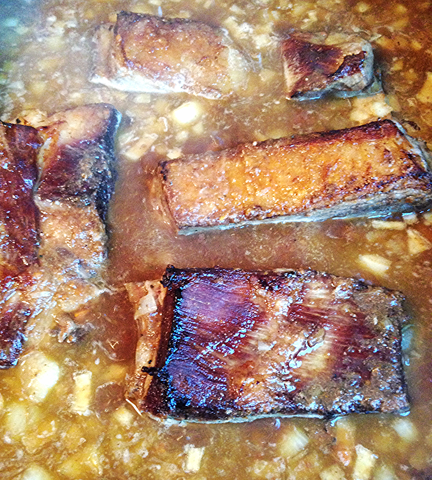 Grass Fed Beef Short Ribs Braising in Liquid