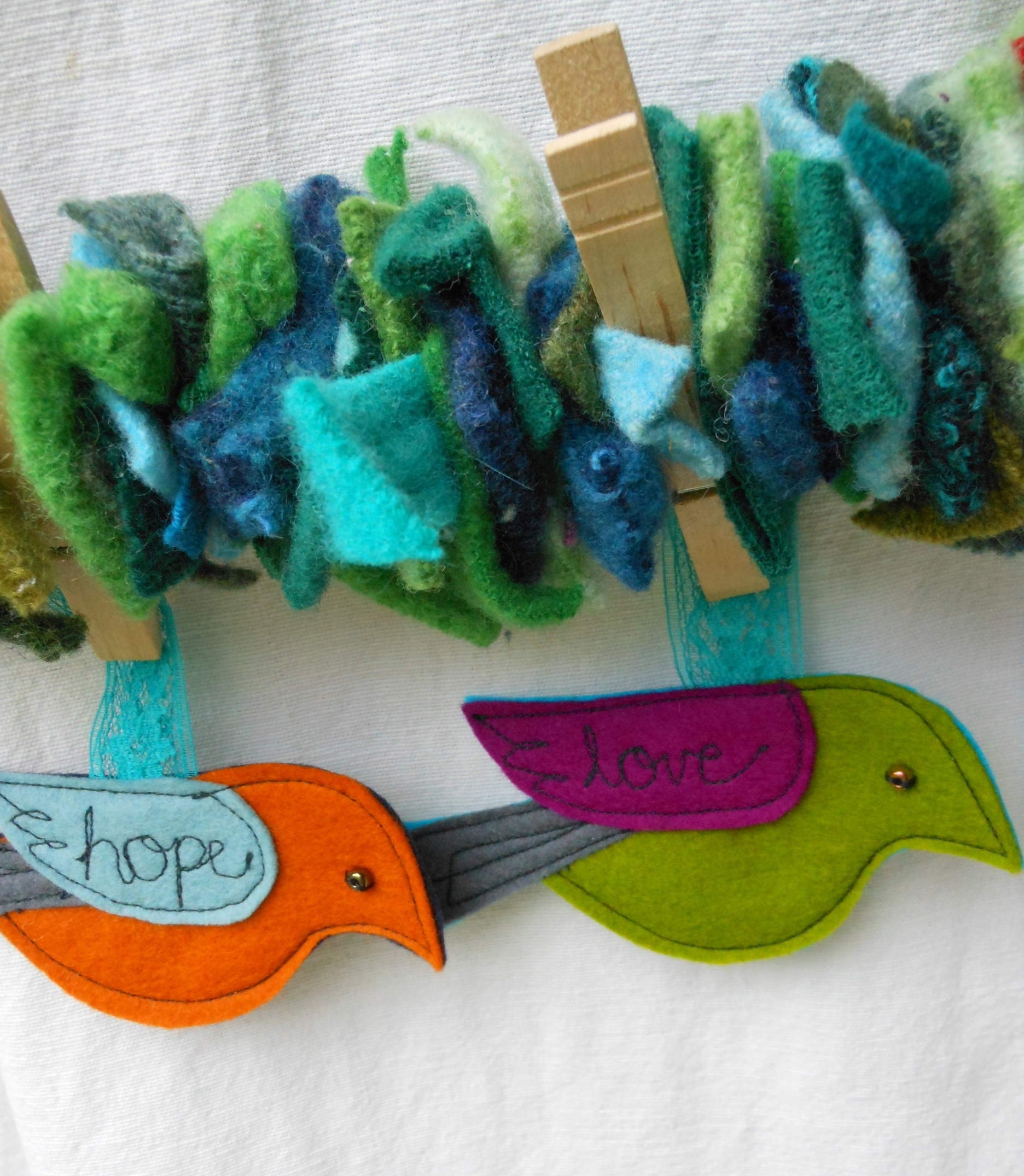Garland made from wool sweater scraps. Ornaments made from wool felt.