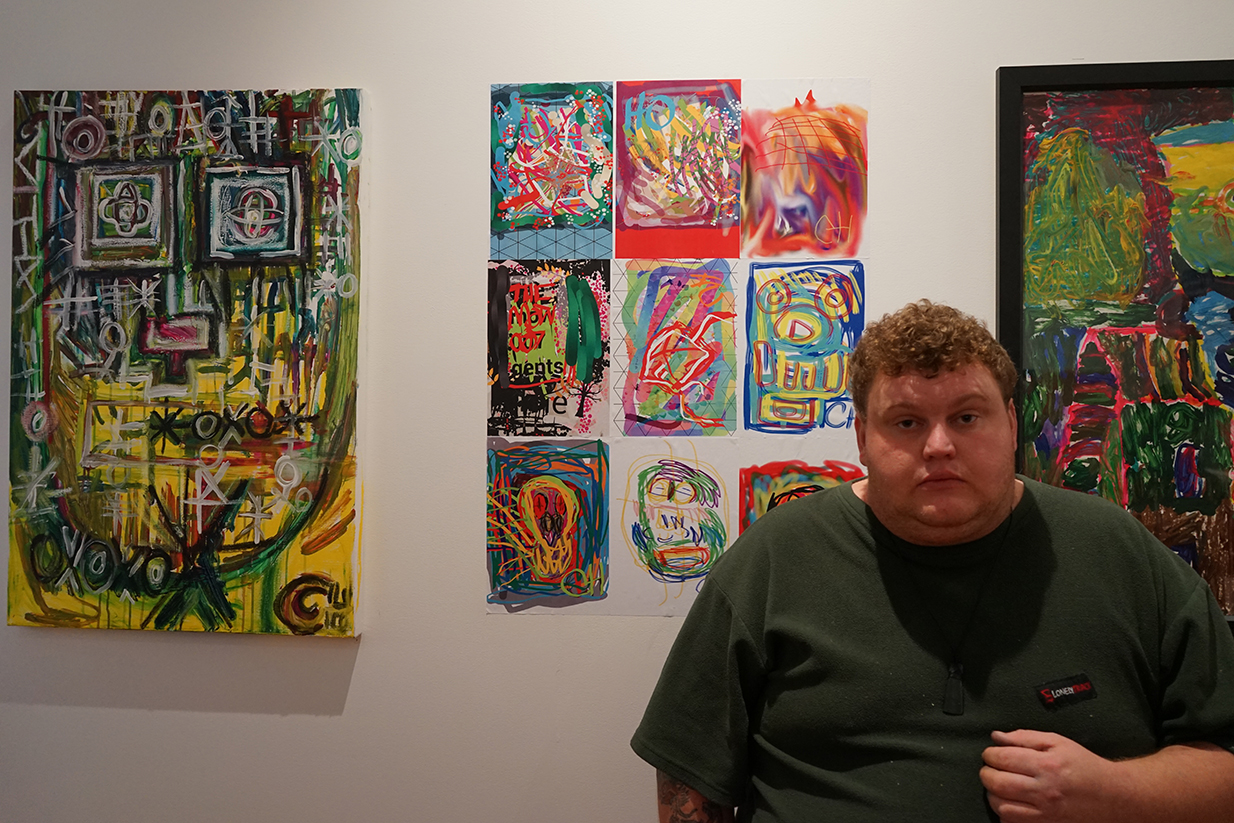 Colin Harris with his two artworks