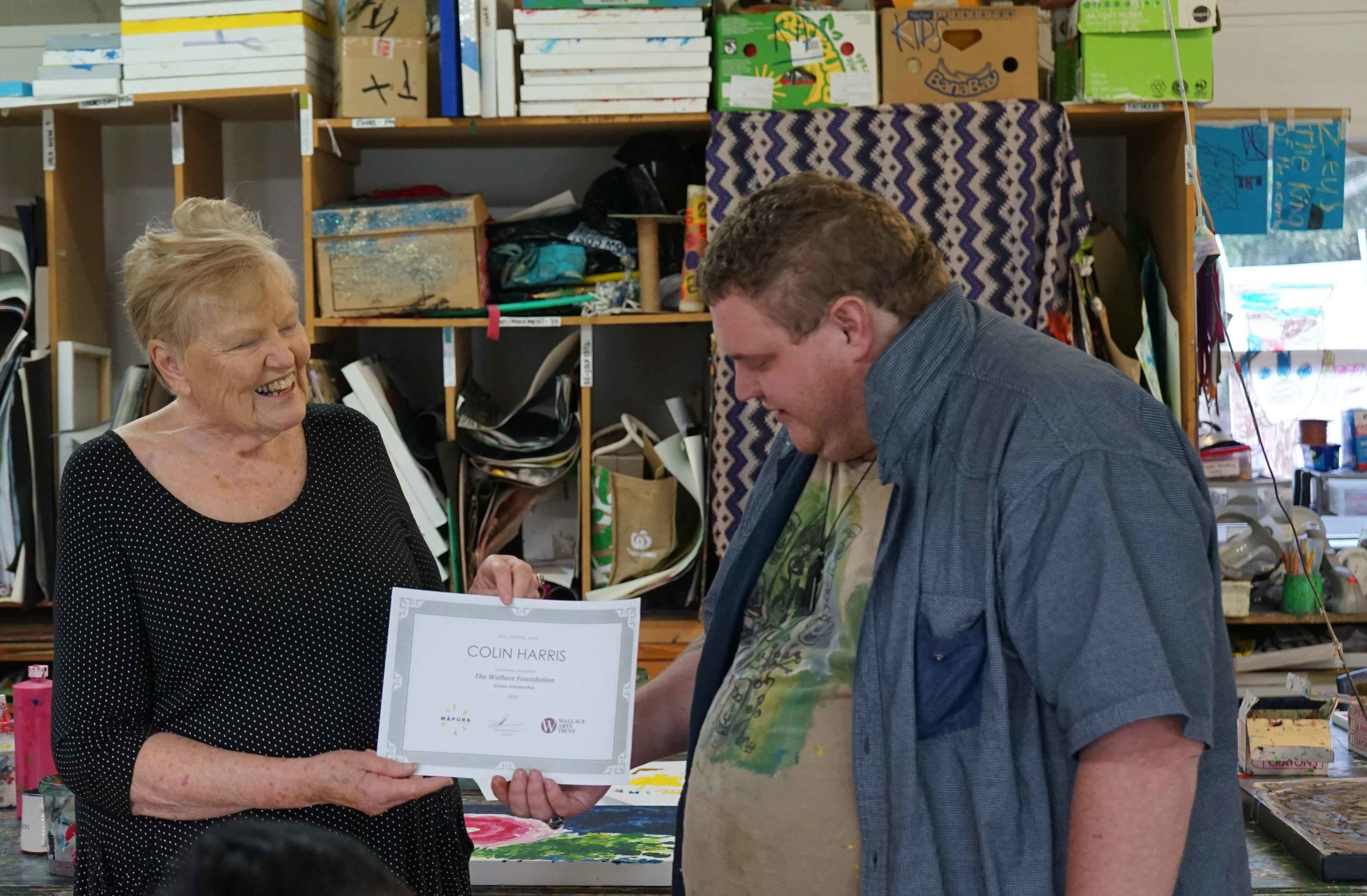 Director Diana McPherson presenting Colin Harris the Wallace Trust Scholarship 2019 at Māpura Studios