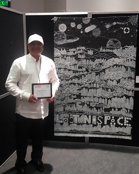 Michael Nathan with his award. Winner IHC Art Awards 2019