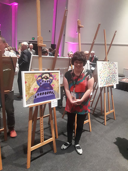Sian Thomas and her painting