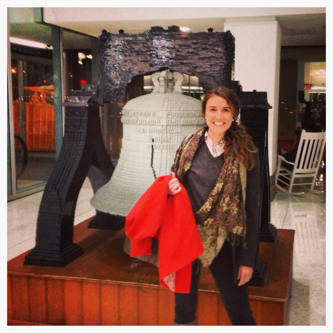 This is me, Megan Bute, in front of thelife-size LEGO model of the Liberty Bell at the Philadelphia airport