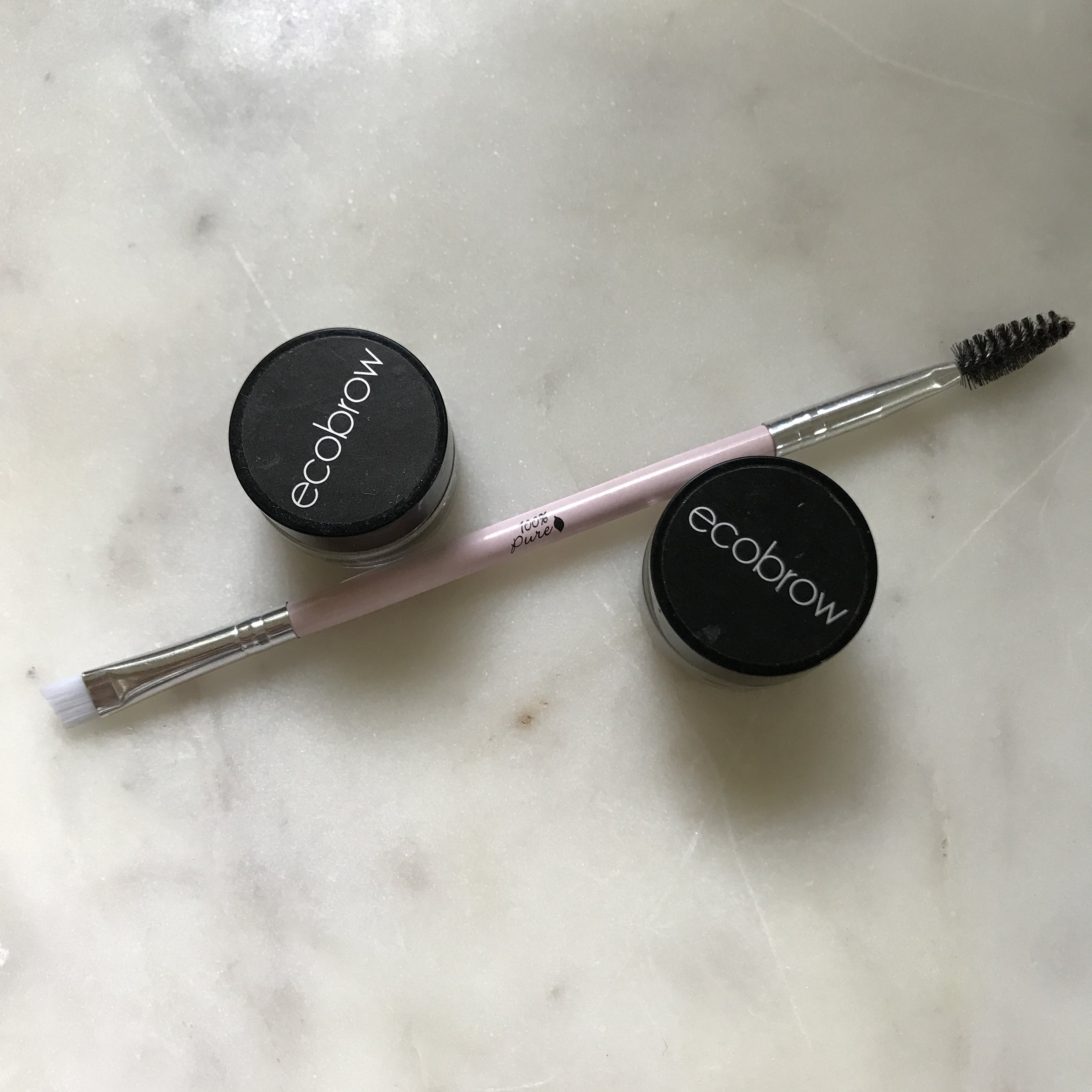 I apply EcoBrow with a thin angled brush like this one from 100% Pure.