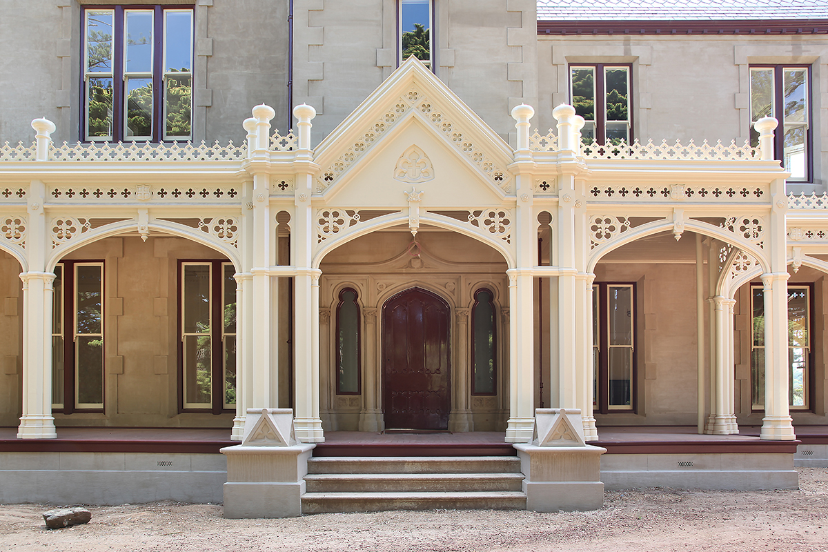 Heritage home decorative verandah posts fretwork and arches.jpg
