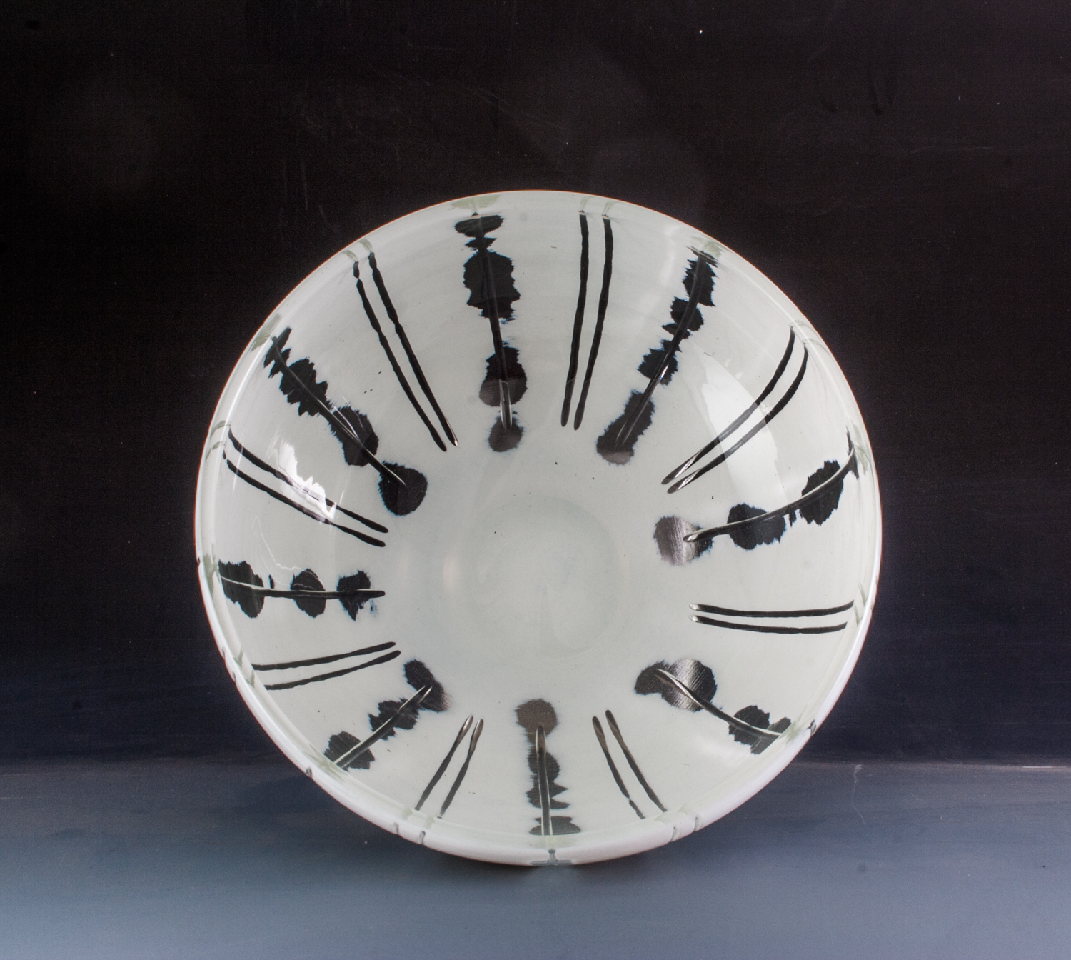 carved white bowl with radial design
