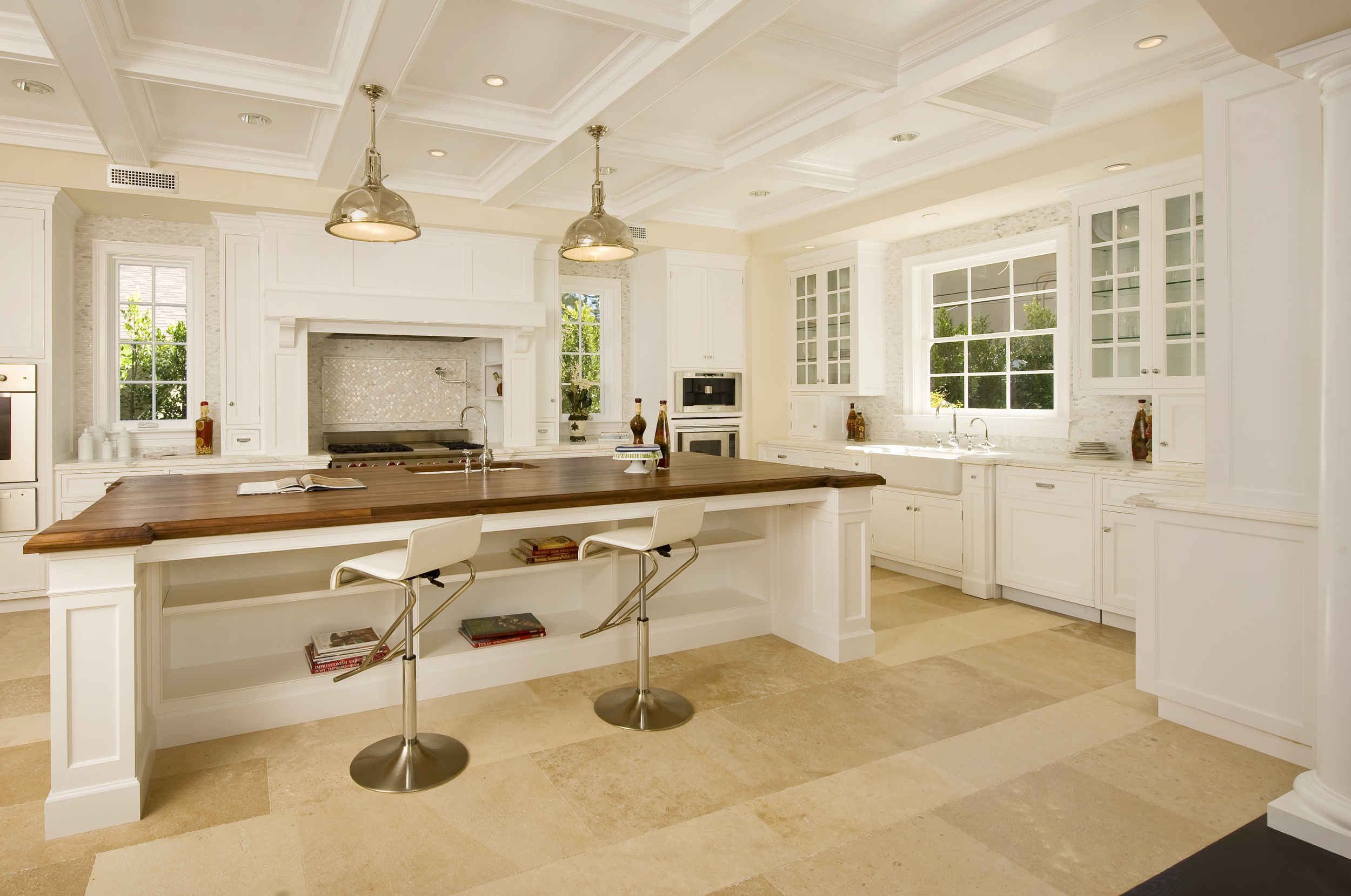 Empire Group. Brentwood Development traditional Kitchen, showing walnut top Island and broken line cabinetry.