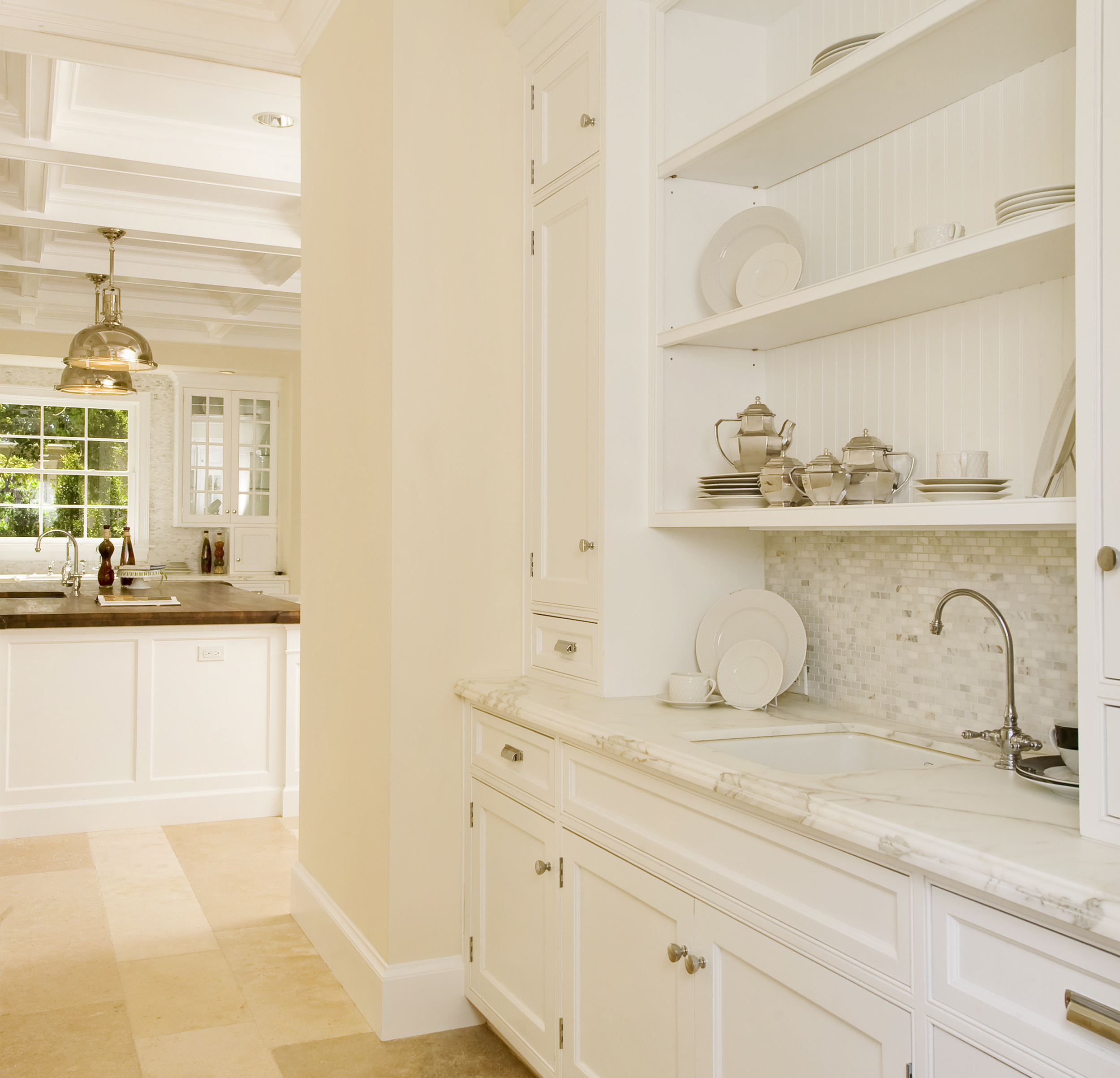 Empire Group. Moreno butler's pantry between Kitchen and Dining room
