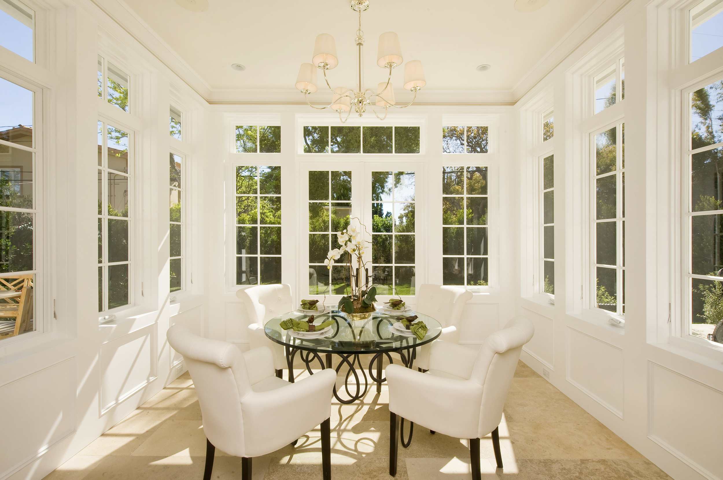 Empire Group. Breakfast room in an all glass conservatory. I used this concept in London many times to great effect.