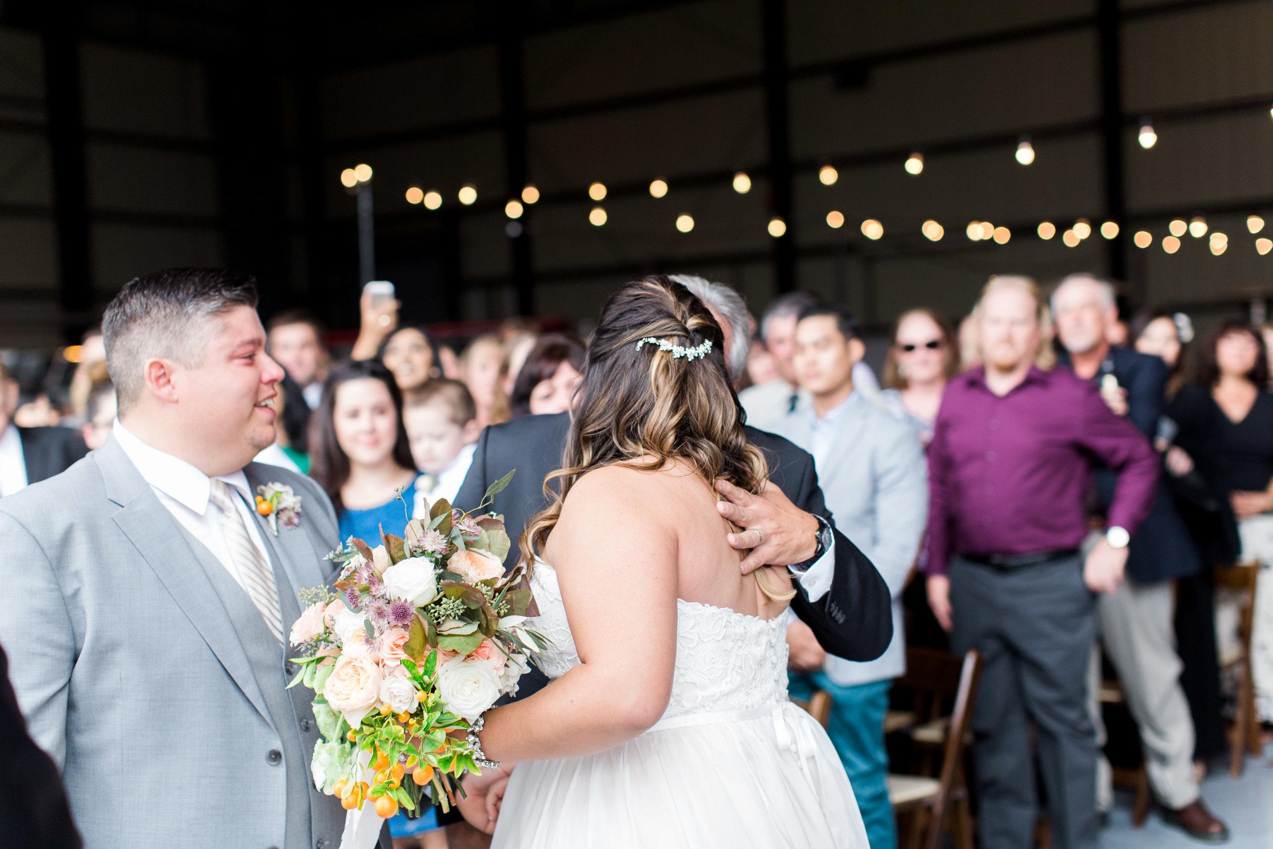 airport-hanger-wedding-at-attitude-aviation-in-livermore-51.jpg