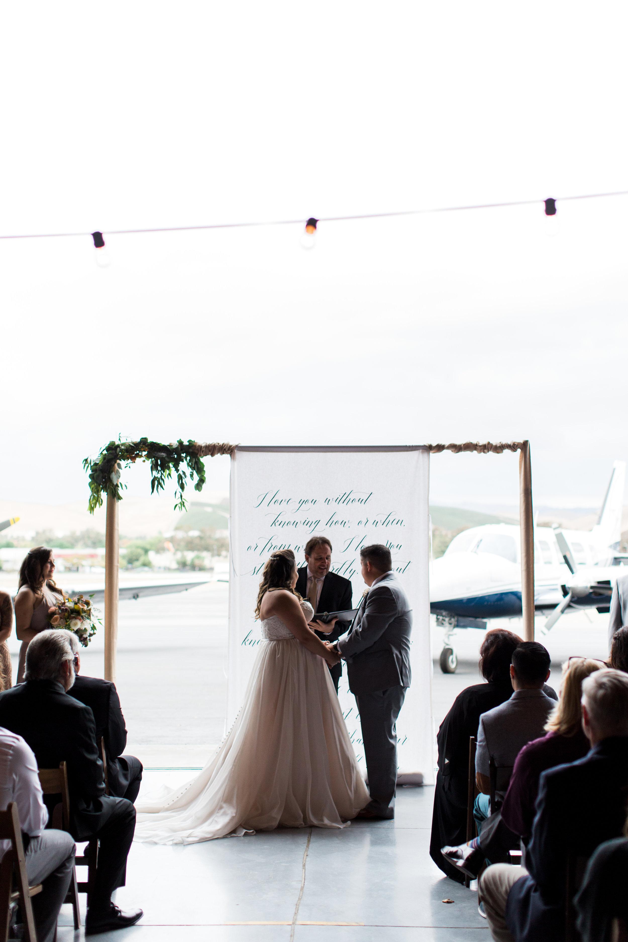 airport-hanger-wedding-at-attitude-aviation-in-livermore-56.jpg