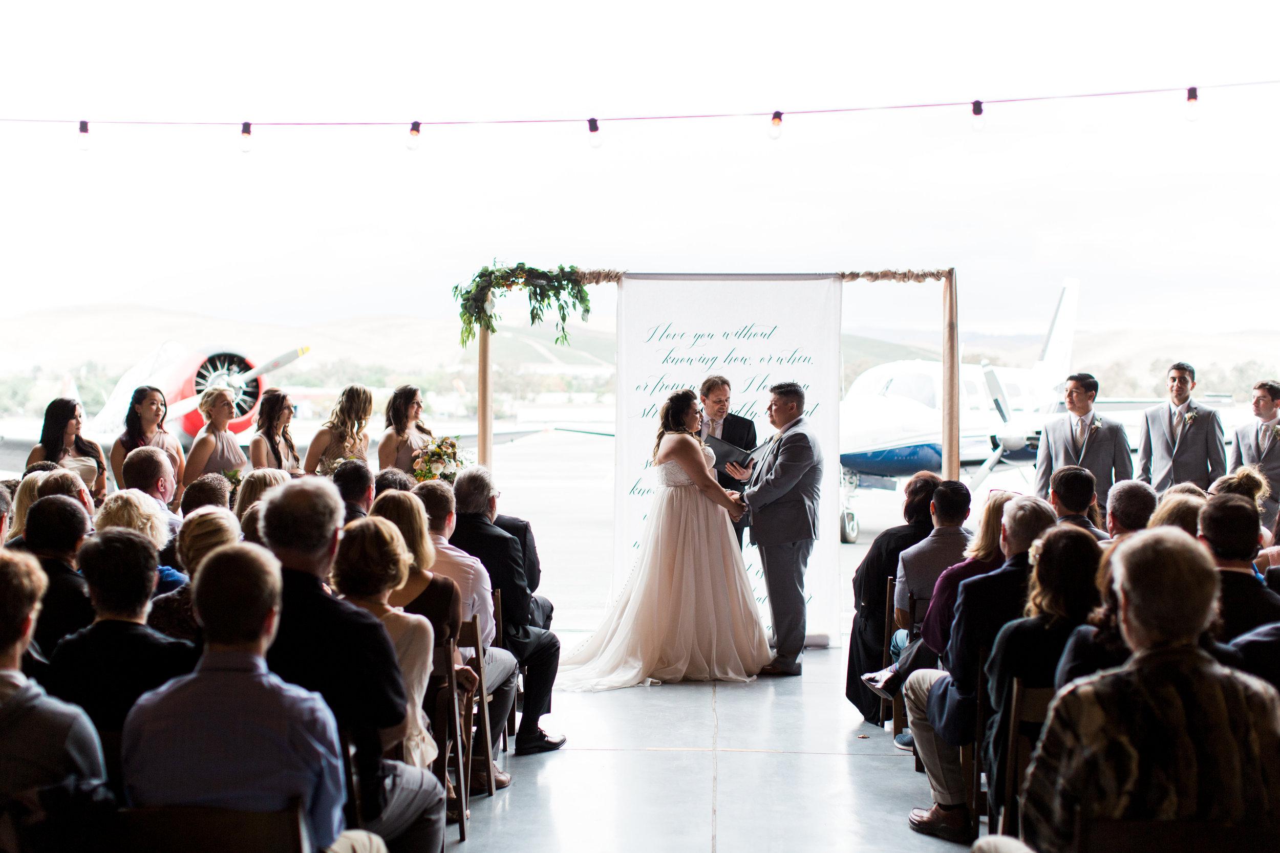 airport-hanger-wedding-at-attitude-aviation-in-livermore-57.jpg