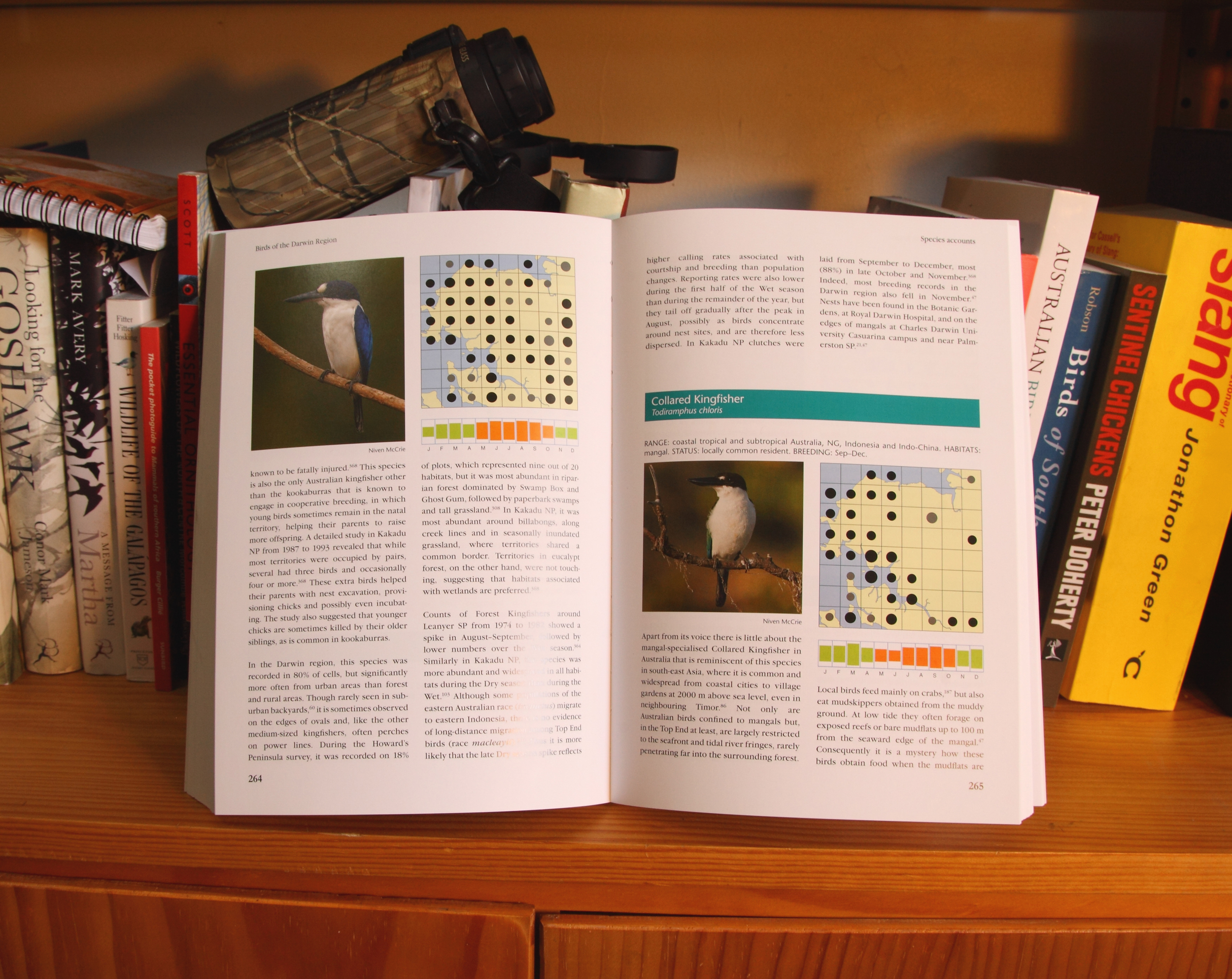 The species accounts are accompanied by seasonality charts, and distribution maps. The region is divided into a grid of 64 cells with explanatory notes at the front of the book detailing the number of surveys providing data for each cell.