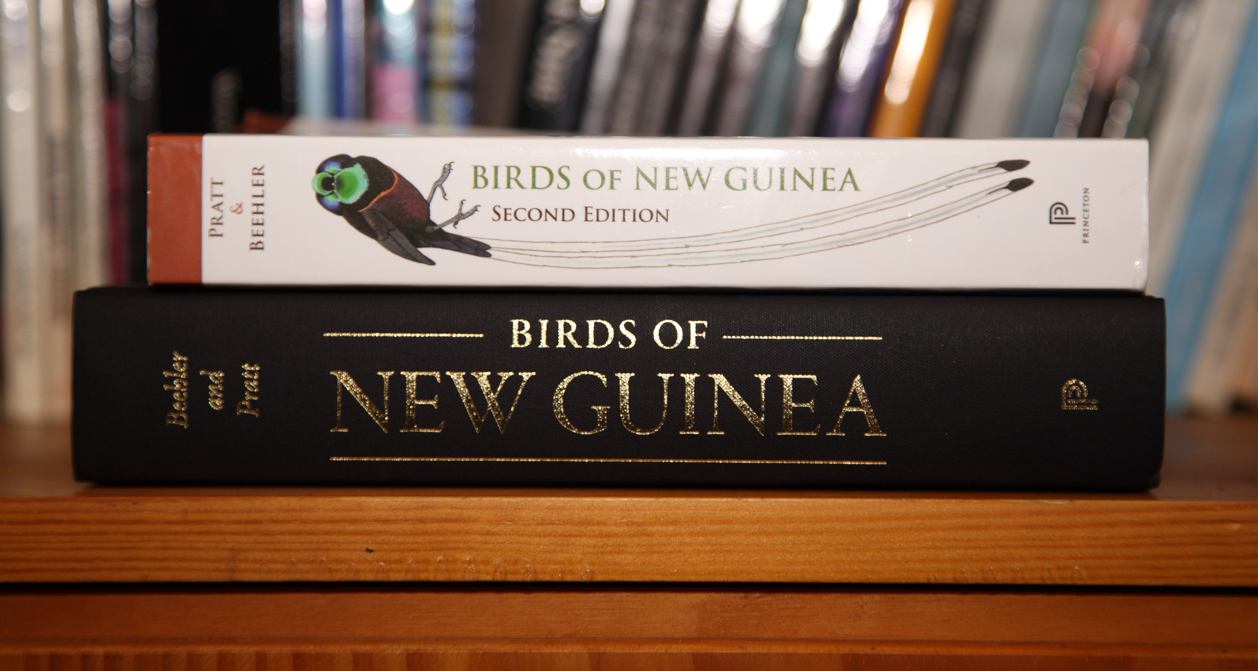 Birds of New Guinea DTS (bottom) with its dust jacket off.