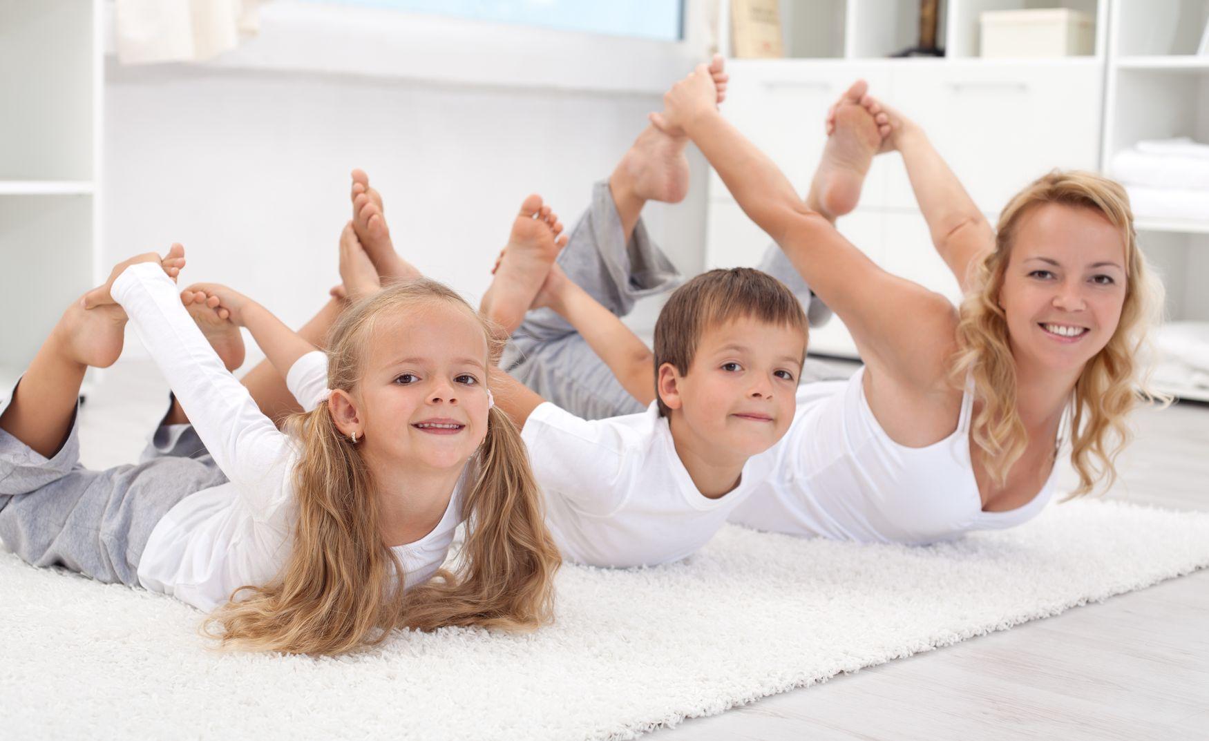 family doing bow pose.jpg