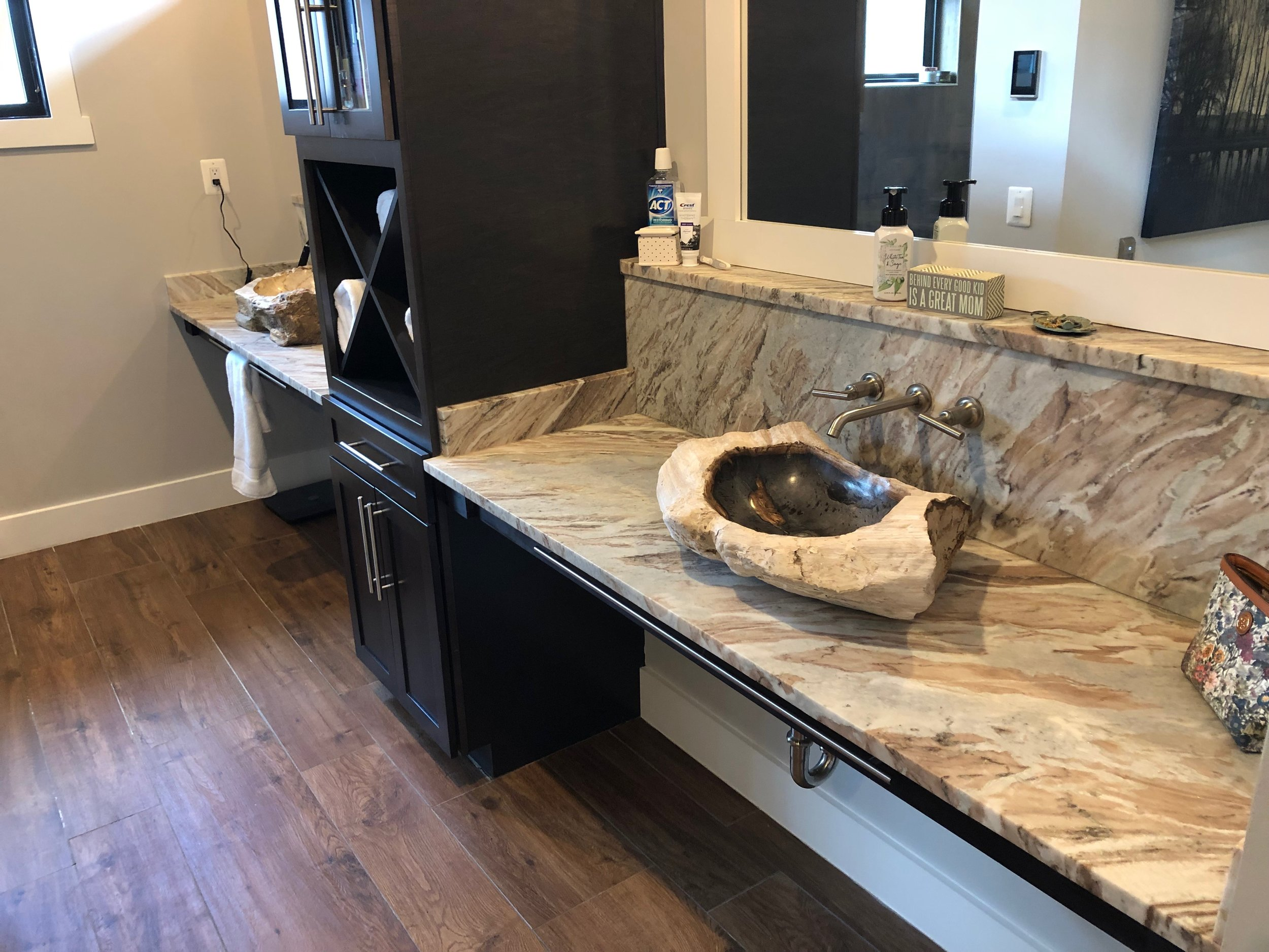 Master bath petrified wood sinks.